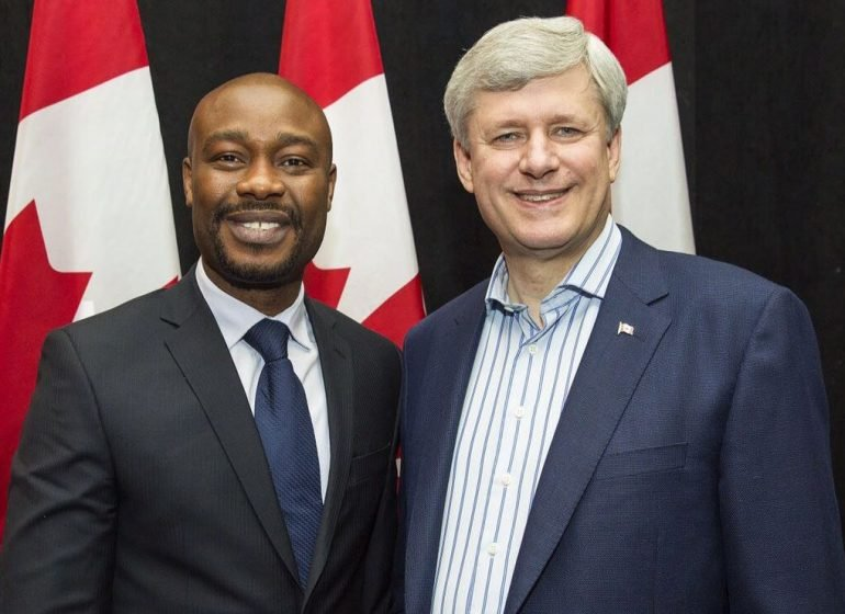 Agboola with ex-Prime Minister Stephen Harper.
