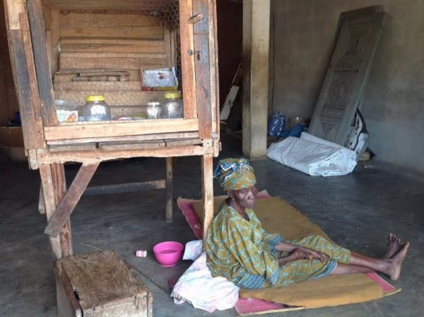 Sekinat Yekini sits at the foot of her empty stall