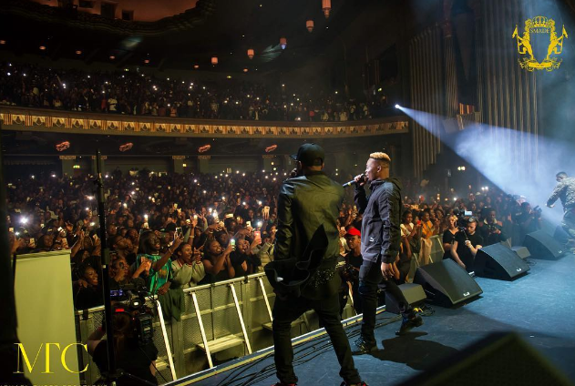 Olamide performing in London