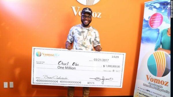 Chief Obi flaunts his BIG cheque