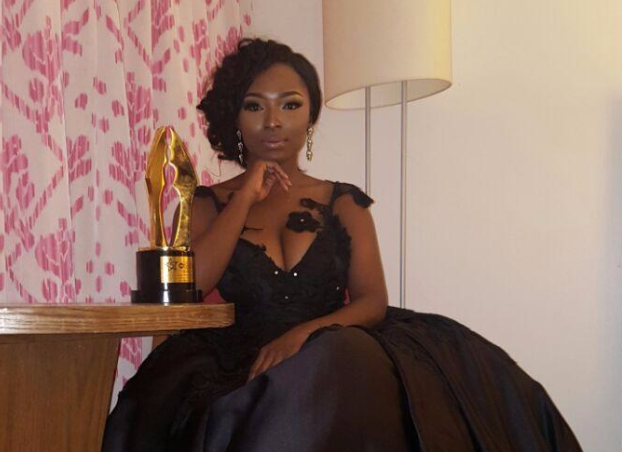Meg Otanwa with her AMVCA 2017 trophy | TheCable.ng