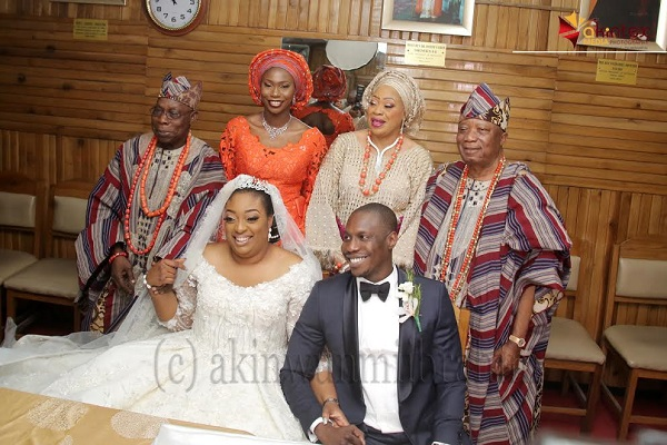 From left to right: Groom's father, Former President Olusegun, his daughter, Mrs. Bunmi Obasanjo-Williams; Bride's parents, Mrs. Roseline, her husband, Chief Kesington Adebutu and the couple, Temitope Adebutu and Adejonwo Obasanjo; during the wedding ceremony of their children held at Methodist Church of the Trinity, Tinubu, Lagos, on Saturday...PHOTO BY AKINWUNMI IBRAHIM
