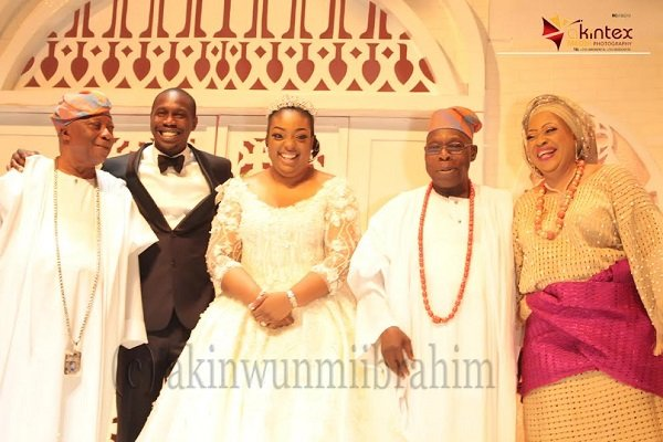 From left: Bride's father, Chief Kesignto Adebutu; the Groom, Olujonwo, the bride,  Temitope; Groom's father, President Olusegun Obasanjo and Bride's mother, Mrs. Roseline; during the wedding ceremony of their children held at Methodist Church of the Trinity, Tinubu, Lagos, on Saturday...PHOTO BY AKINWUNMI IBRAHIM